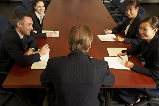 Decision makers discussing outsourcing.